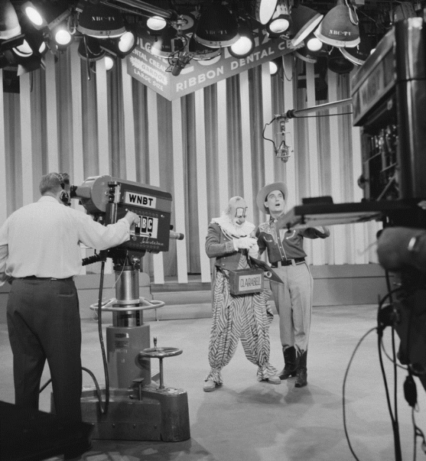HOWDY DOODY -- Pictured: (l-r) Lew Anderson as Clarabell the Clown, Bob Smith as host Buffalo Bob Smith during taping of the Colgate 5th Anniversary party -- Photo by: NBCU Photo Bank
